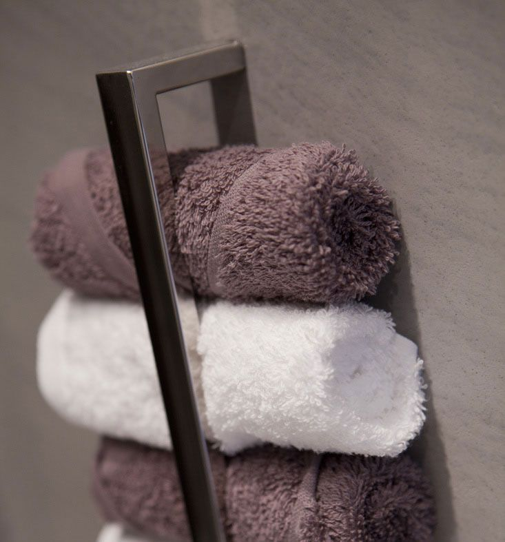 Hang a towel rail vertically to store rolled towels, this might just be the smartest thing I've seen for towels!