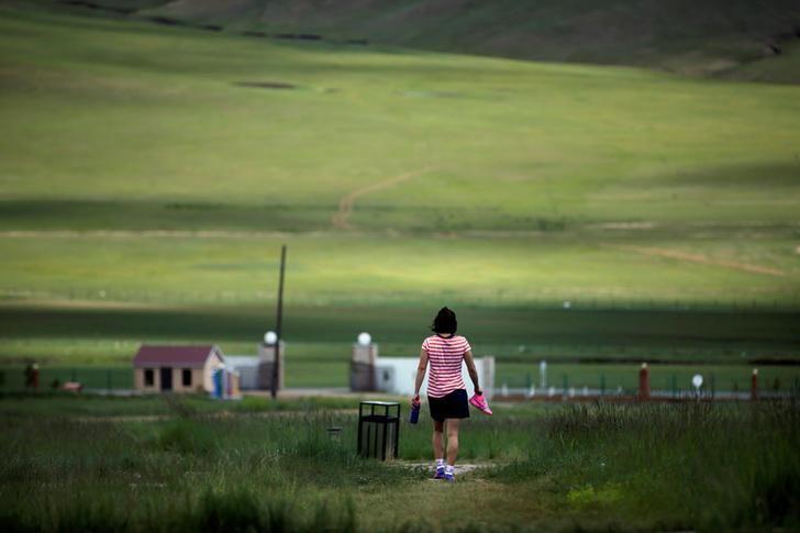 OLYMPICS-RIO/WRESTLING-MONGOLIA Mongolia's Olympic wrestler Battsetseg Soronzonbold walks toward the dormitory after a daily training session at the Mongolia Women's National Wrestling Team training centre in Bayanzurkh district of Ulaanbaatar, Mongolia. REUTERS/Jason Lee