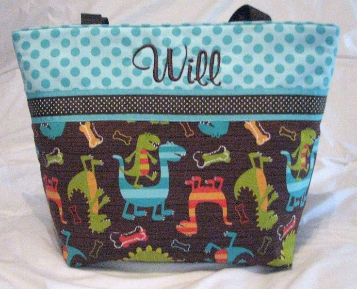 Personalized Diaper Bag in DINO DUDES . Regular size . Monogramming INCLUDEd . great boy diaper bag by DoodlescootDesigns on Etsy https://www.etsy.com/listing/60266311/personalized-diaper-bag-in-dino-dudes