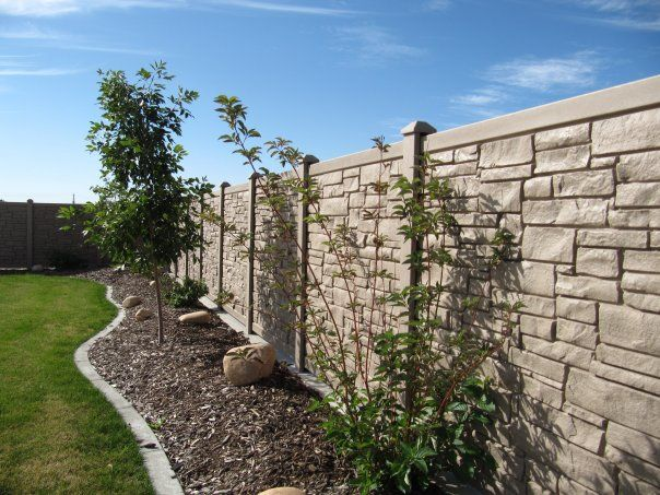 Simtek Rock fence. Much cheaper than real stone and you can't tell the difference.