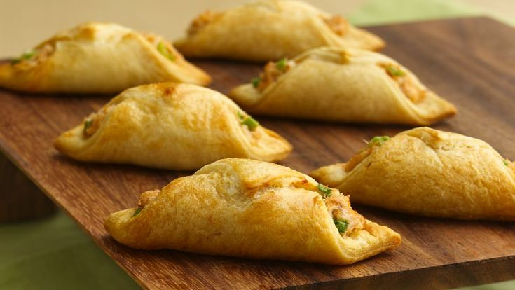 These Asian-inspired appetizers start with a flaky crescent roll pastry wrapped around cream cheese and crab filling.