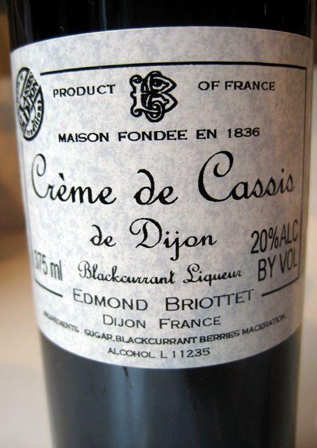 Essential ingredient to kir, made of 1 part crème de cassiparts about 3 parts crisp white wine.