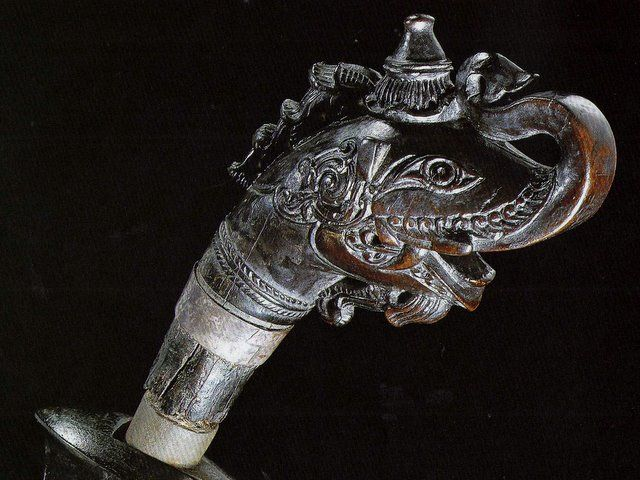 a makara hilt on a mid 19th Century, badek from Pattani.  Although not the same form, here showing a variant of a makara hilt form. This example have a langkasukan motif, a swirling foliage, at the ear area, (behind the eyes).. which is a feature on many tajong hilts..