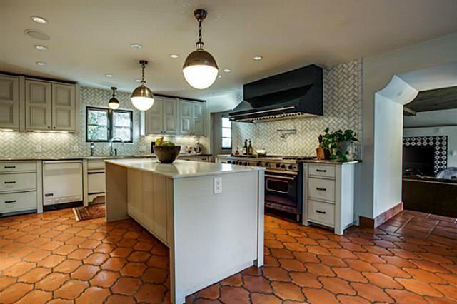 saltillo tile light gray cabinets wood baseboards