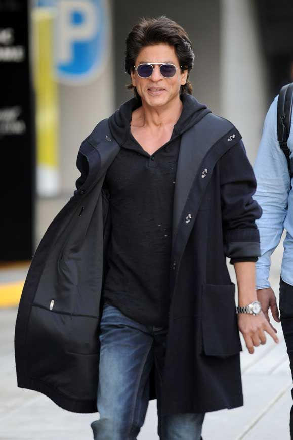 Shah Rukh Kahn was pictured in Vancouver, Canada looking cool in a hooded sweatshirt under his long jacket and wearing oval sunglasses with purple lenses. All pictures are copyrighted by © Atlantic Images Strictly No Use /