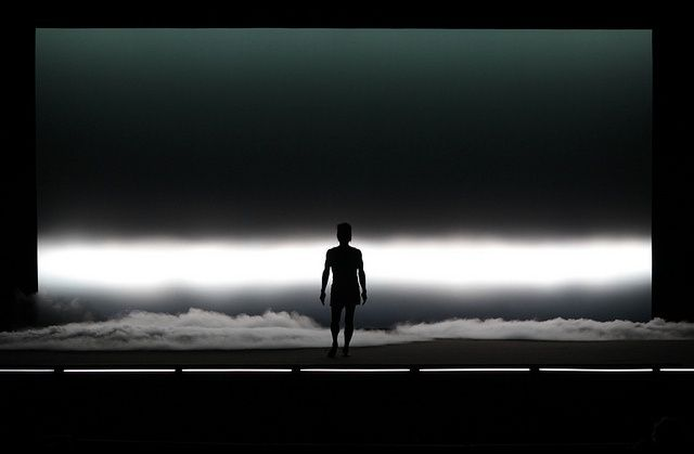 The lighting designer decided to have an intense white light behind him, thats on the bottom lower of the cya, to only show the sharp silhouette of the performer. This is great for a dance show and it helps to describe the setting, since we see the clouds forming on the bottom of the stage.