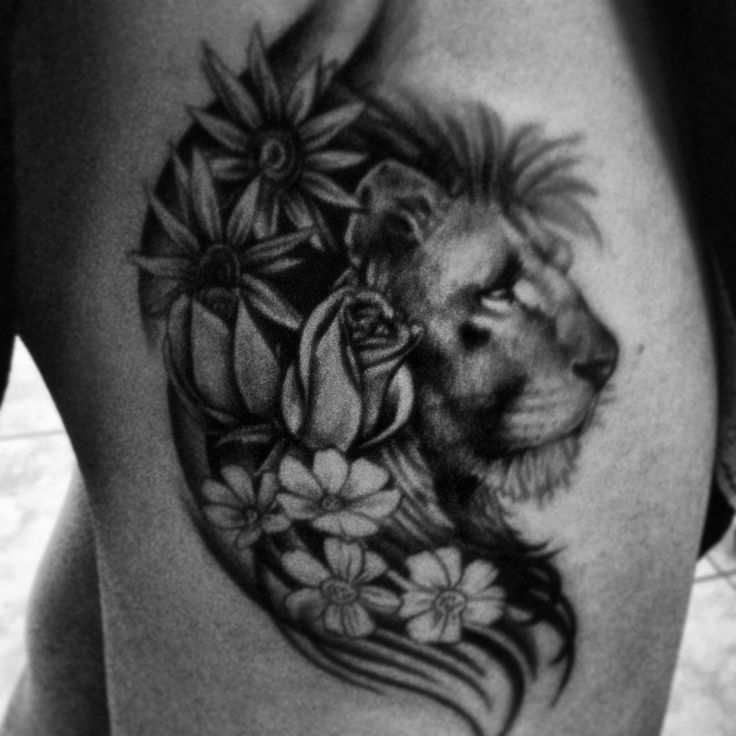 Lion tattoo with flowers.