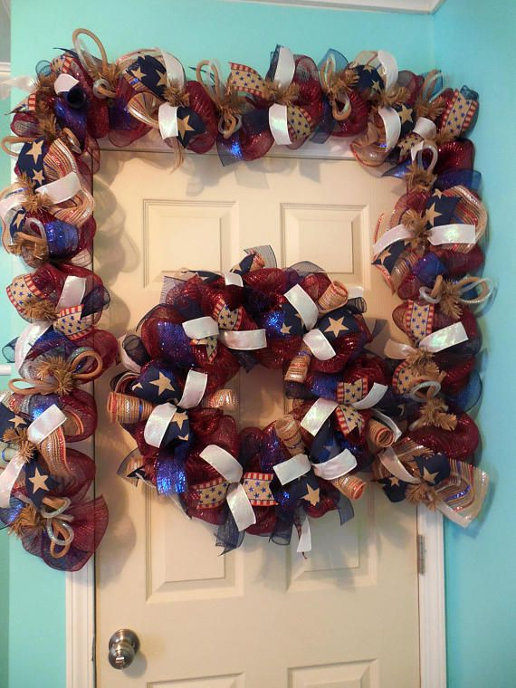 This super full and patriotically festive garland is waiting for your door, bbq or party! Created with a burgundy base deco mesh, this garland is filled with twists, ruffles and deco mesh ribbon consisting of burlap, red, and blue! The ribbons on this piece are patriotic print and
