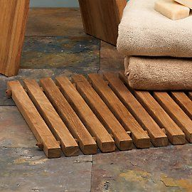 I love the aesthetic of a teak mat on tile as you step out of the shower.