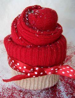 Sock Cupcake tutorial @ http://laurenm.blogs.splitcoaststampers.com/2009/03/19/video-how-do-you-make-a-cupcake/
