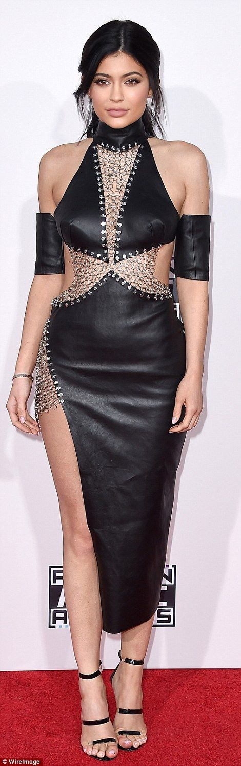 Cut-out queen: Kylie, 18, rocked a raunchy leather look with silver chainmail detail