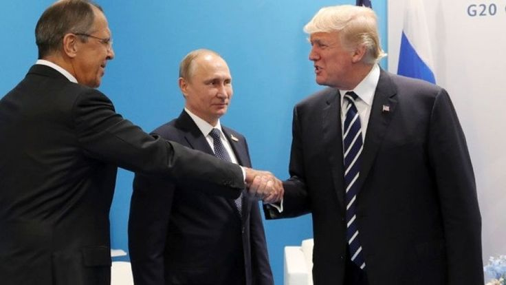 File photo: U.S. President Donald Trump, right, greets Russian Foreign Minister Sergey Lavrov, left, prior his talks with Russian President Vladimir Putin, center, during the G20 summit in Hamburg Germany, Friday July 7, 2017. (Mikhail Klimentyev, Kremlin Pool Photo via AP)
