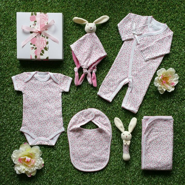 Spring is in the air with this gorgeous baby girl hamper. With its spring blossom design baby clothing this baby hamper will make the perfect new baby girl hamper. #babygirlgift #babygirlhamper