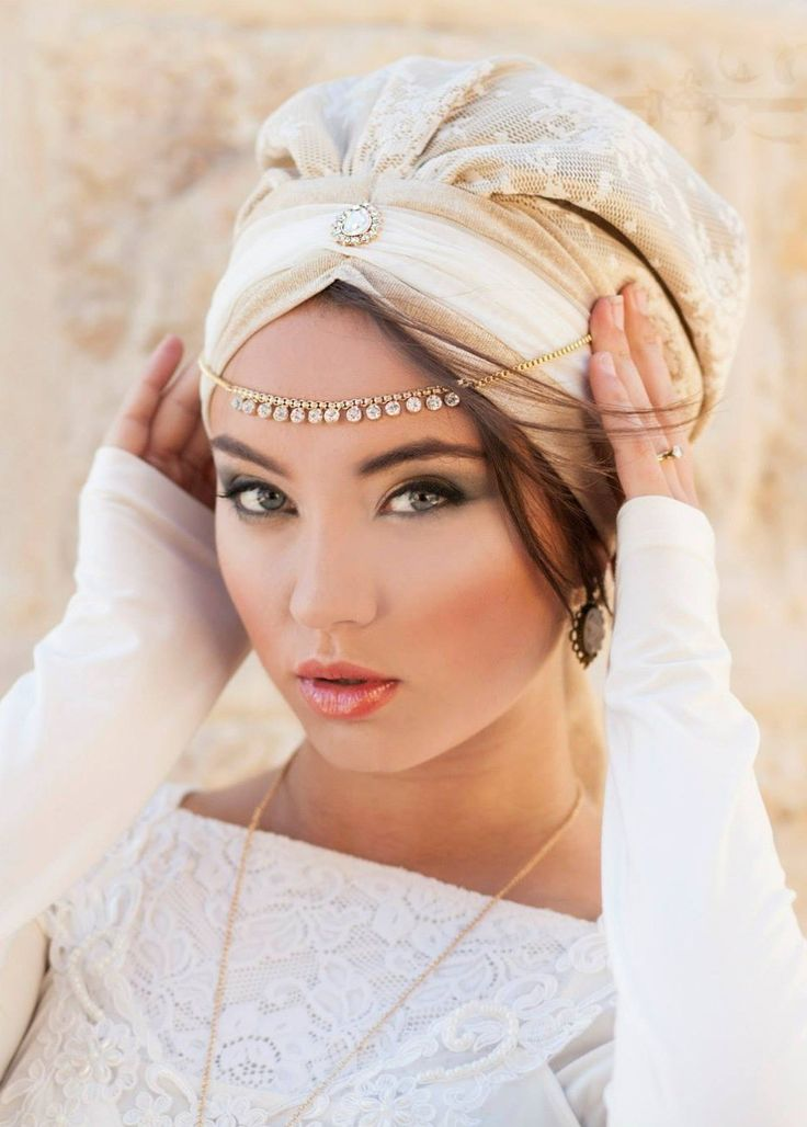 Festive, unique pre-sewn turban! This head covering is intricately sewn to create the shape of a turban- all you need to do is place it on your head and tie! This turban was designed down to the last detail,  made of camel and cream lace-satin and lycra-t