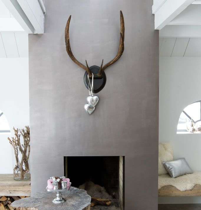 fireplace in matte grey with big wooden shelf running length of room