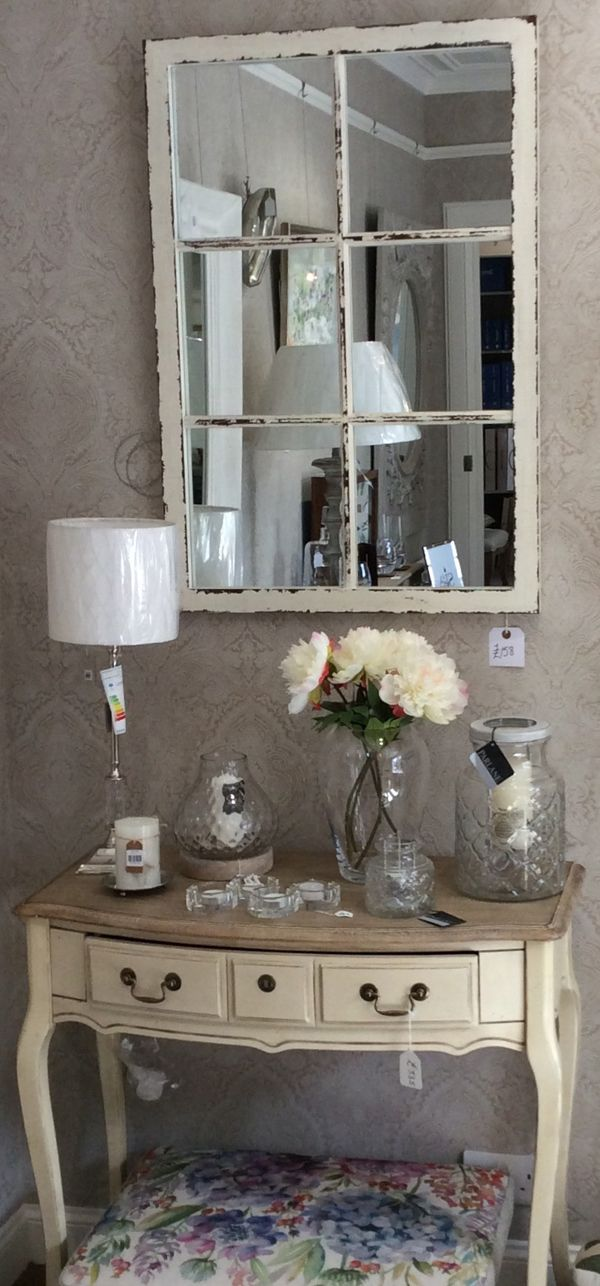 Wallpaper by window pane effect mirror voyage hydrangea foot stool and glass candle holders by parlane international