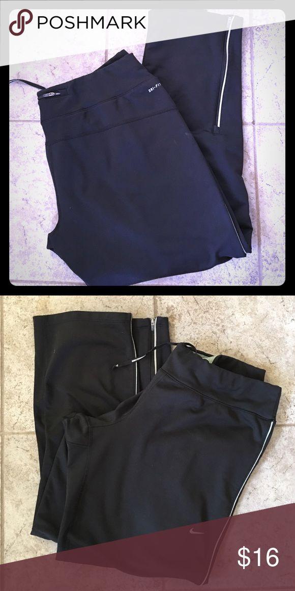 Nike running pants Thermal nike running pant.  Drawstring at waist , zip down by ankles. Zip key pocket on back. Nike Other