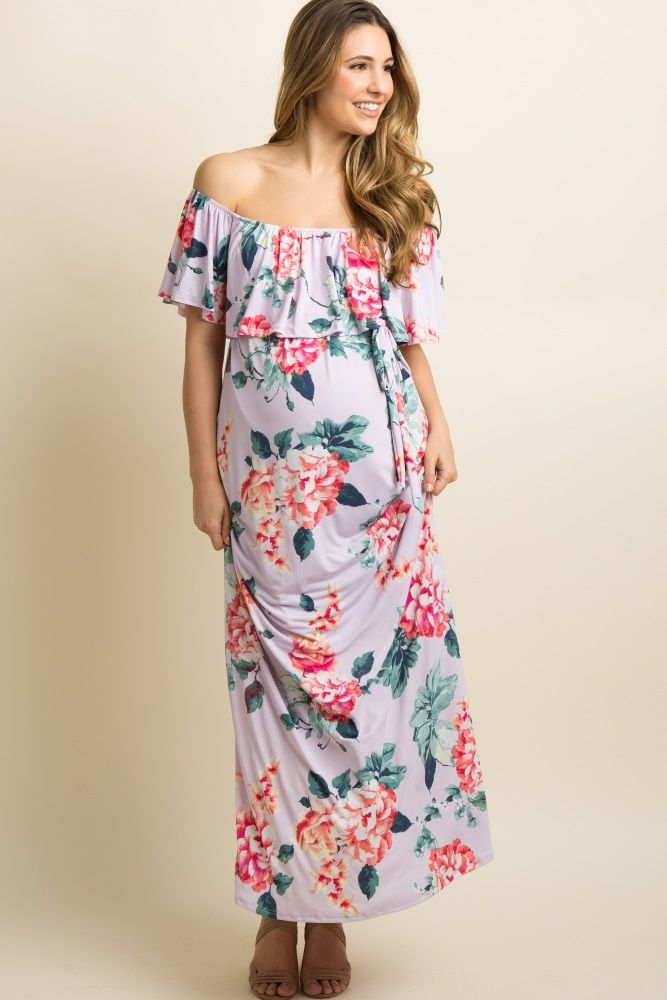 247d0bfbf9fe1 A floral print maternity maxi dress featuring a cinched elastic off shoulder  neckline with a ruffle trim, belt loops with a sash tie, and double lining  to ...