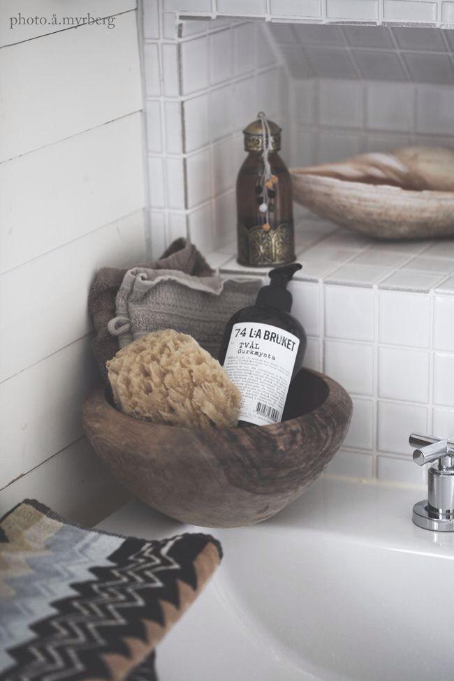 bathroom storage with bowls & baskets