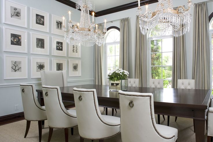 Contemporary dining room with classic chairs, chandeliers and frames. #KBHome