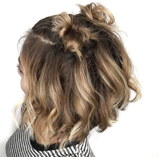 Two little hair buns with shoulder length hair