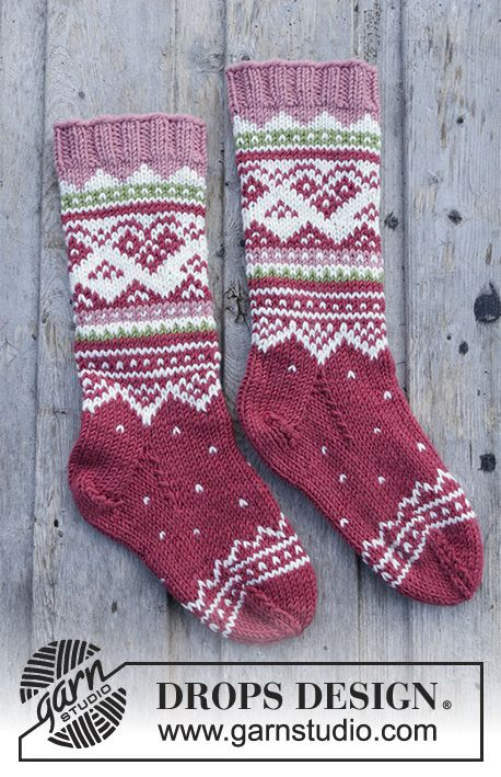 Visby Socks - Knitted socks with multi-coloured Norwegian pattern for kids. Sizes 24 - 37. The piece is worked in DROPS Merino Extra Fine. Free knitted pattern DROPS Children 30-12