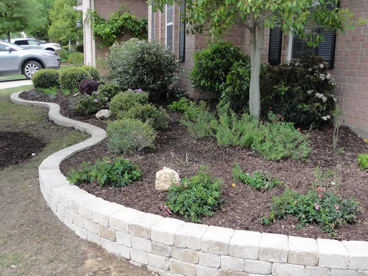 small retaining wall with capstone garden with small