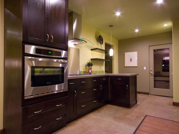 Wall mount oven and simple, modern cabinets.