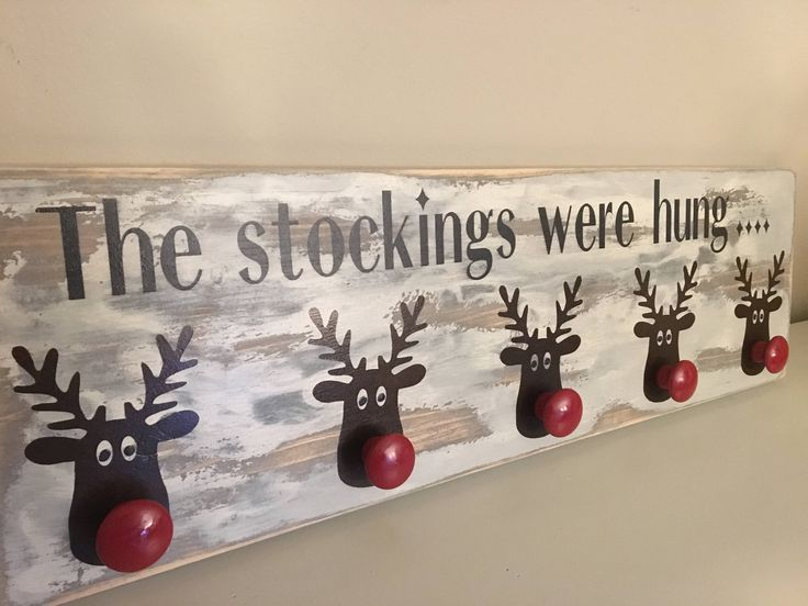 "Free Shipping Canada & USA - Rustic Distressed on reclaimed Barn Board - Reindeer Sign Stocking Hanger holder 7.5"" X 24"" holder mantle by BrasdorRusticDecor on Etsy https://www.etsy.com/listing/570322341/free-shipping-canada-usa-rustic"