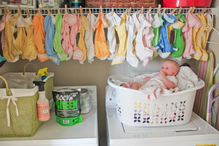 Love this! haha, that is quite a cloth diaper stash! Nice way to hang dry all the covers too.
