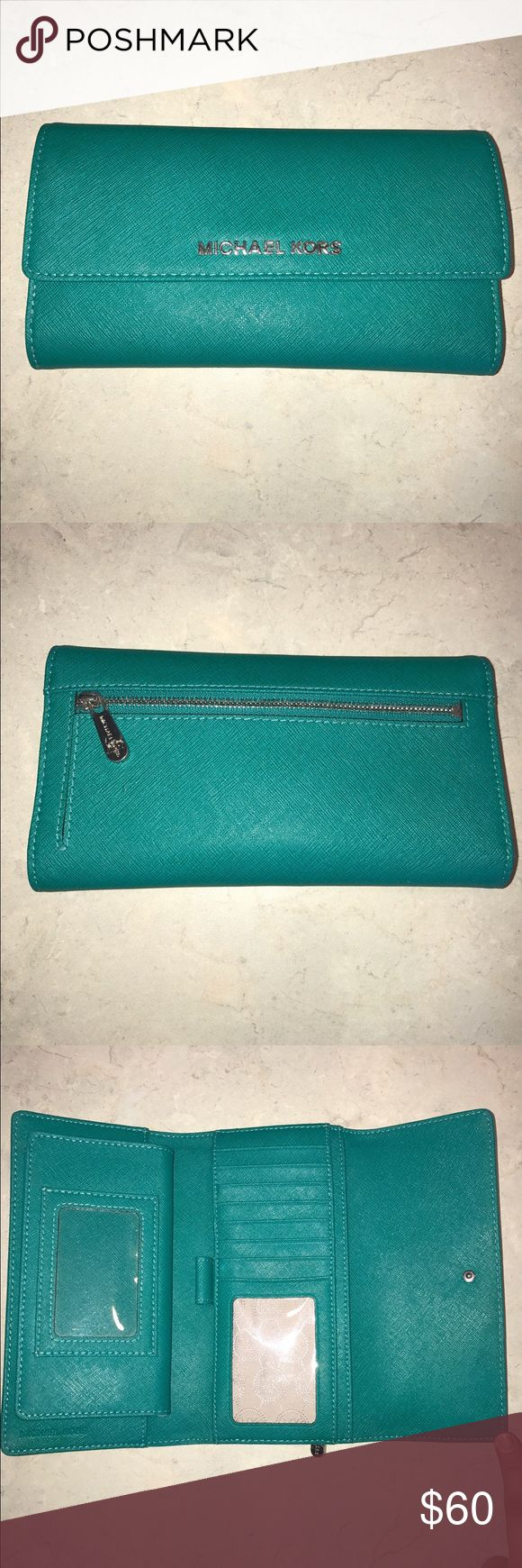 Michael Kors Jet Set Leather Checkbook Wallet Condition: like new; Large leather Michael Kors wallet with removable checkbook flap. Color: turquoise Michael Kors Bags Wallets