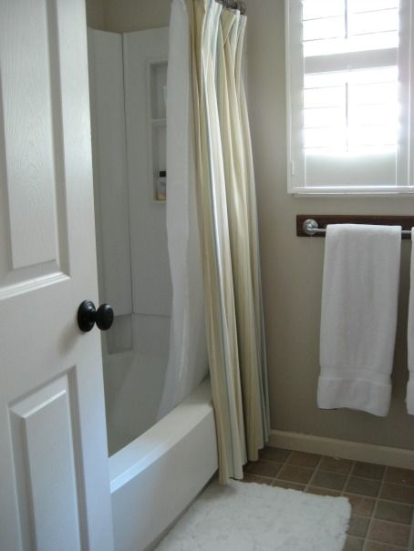 decorate around a fiberglass tub shower combo enclosure