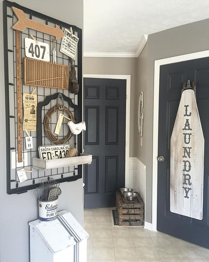 Just finished up my Saturday DIY... Old crib springs turned decor board!  I have been collecting vintage items like the yard stick, newspaper ad, bingo card, license plate, printer drawer and metal pulley to display here. || Wall color Fashion Gray by Behr ||Trim Bleached Linen also by Behr ||doors custom color match to Americana Decor craft chalky finish paint in Relic || #diy #cribspring #repurpose #vintagedecor
