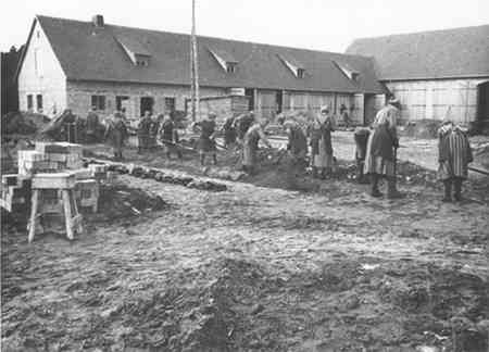 Female prisoners at forced labor digging trenches at the Ravensbrueck concentration camp. This photograph is from the SS-Propaganda-Album des Frauen-KZ-Ravensbrueck 1940-1941.