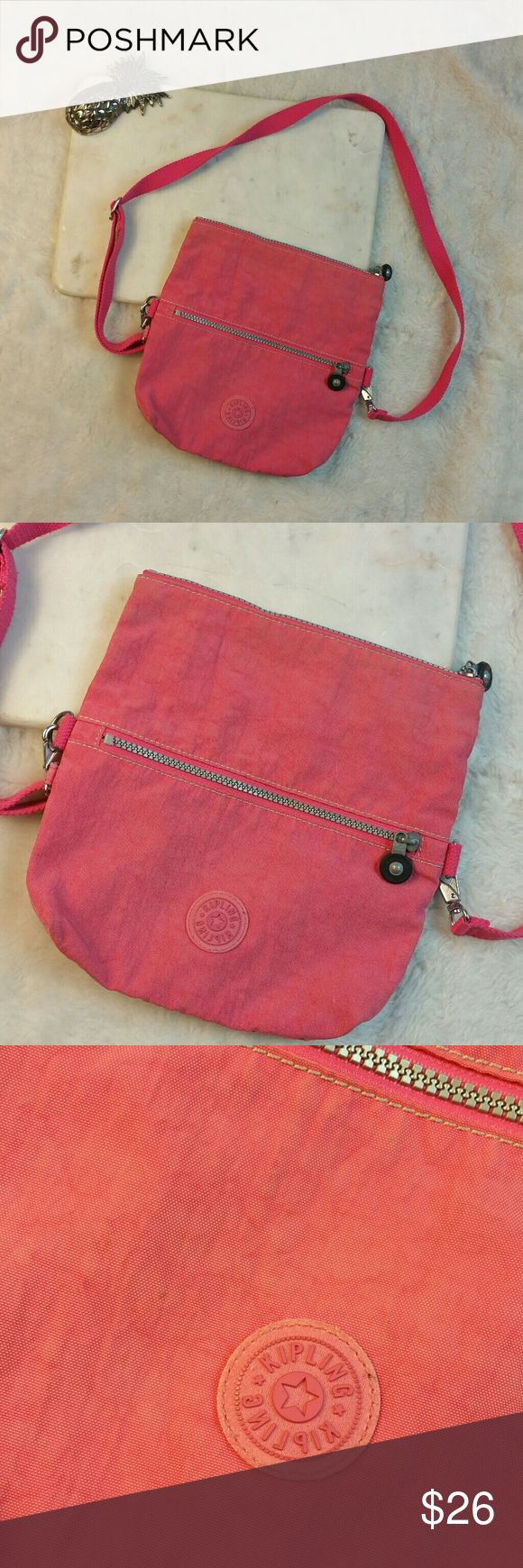 Kipling Frug s handbag cross body pink Kipling Frug s handbag cross body pink  Good condition light discoloration   Wear two ways. You can fold over or not.   Great for everyday or travel   9in across 10in bottom to top Kipling Bags