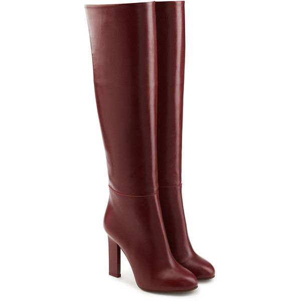 See this and similar Victoria Beckham knee high boots - Coated in supple bordeaux leather with no fussy details and a streamlined knee-high shaft, these heeled...