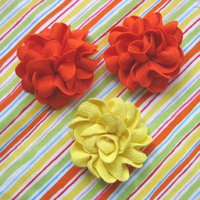 Flowers made from rickrack. @Elizabeth Drouillard Now I know what to do with all that rickrack.
