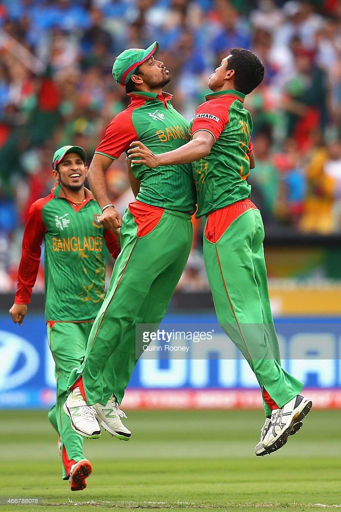 Taskin Ahmed of Bangladesh is congratulated by Mashrafe Mortaza after  getting the wicket of Ajinkya Rahane of India during the 2015 ICC Cricket  World Cup ...