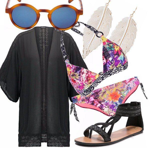 Per unestate da urlo: bikini sgargiante, mantella nera con ricami, sandali in stile boho e maxi orecchini a piuma. Aggiungete dei tattoo in oro per un tocco glam in più. Infine, indispensabili a completare il look, gli occhiali da sole specchiati.