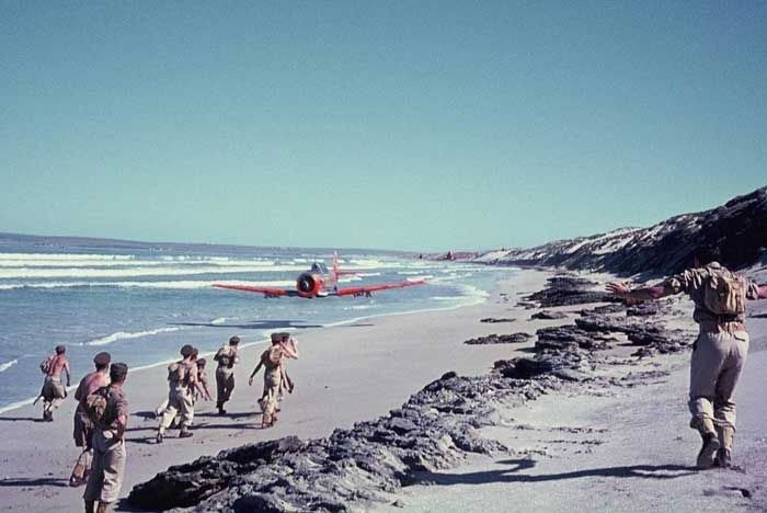 South African Air Force Harvard trainer rips up a beach on the Atlantic coast near Saldanha Bay with its propeller tips no more than three feet from the sandy surface.
