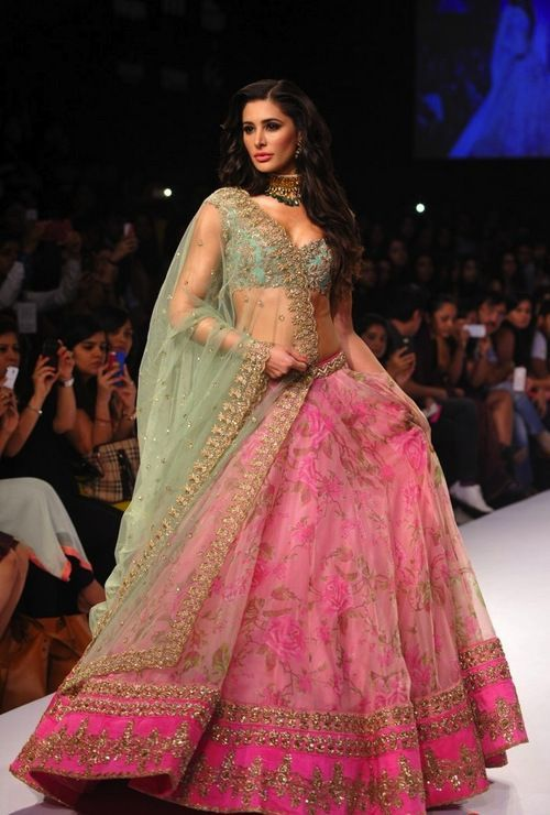 Nargis Fakhri in Anushree Reddy Floral lehenga. Anushree Reddy's Portobello collection is full of soft pinks and mint greens with floral touches for the vintage bride. A beautiful outfit for an engagement, sangeet or reception. Indian bride - Indian wedding - Indian designer - Indian couture #thecrimsonbride