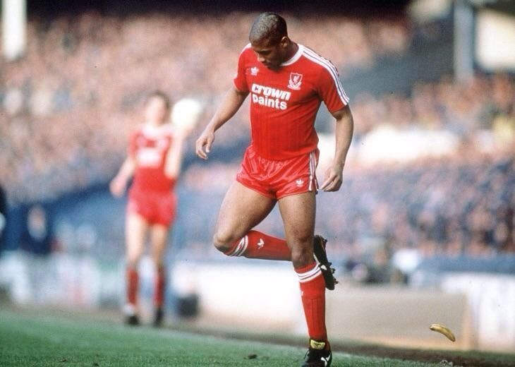 John Barnes, the first high-profile black English footballer, back-heels a banana off the Goodison Park pitch during a 1988 FA Cup tie.