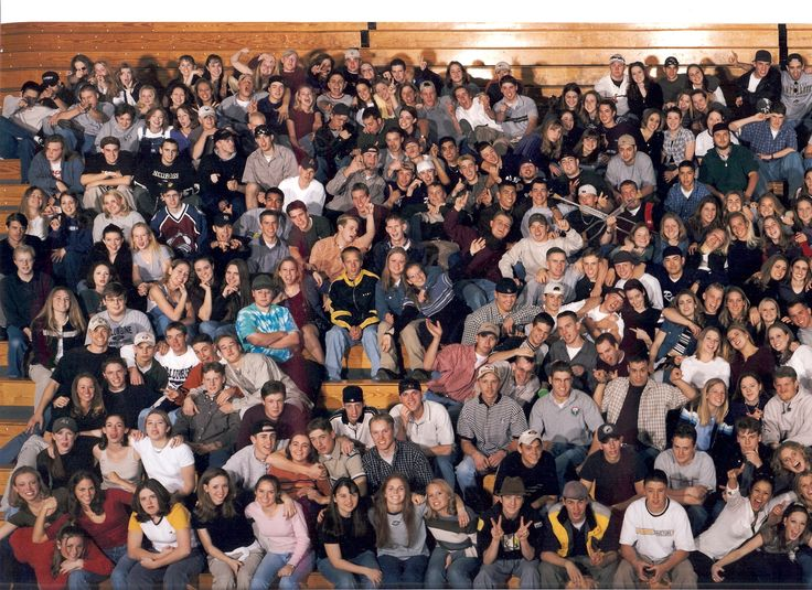 Columbine High School Class of '99 Group Picture. Eric Harris and Dylan Klebold are in the top left making a shooting gesture at the camera. [2338x1700]