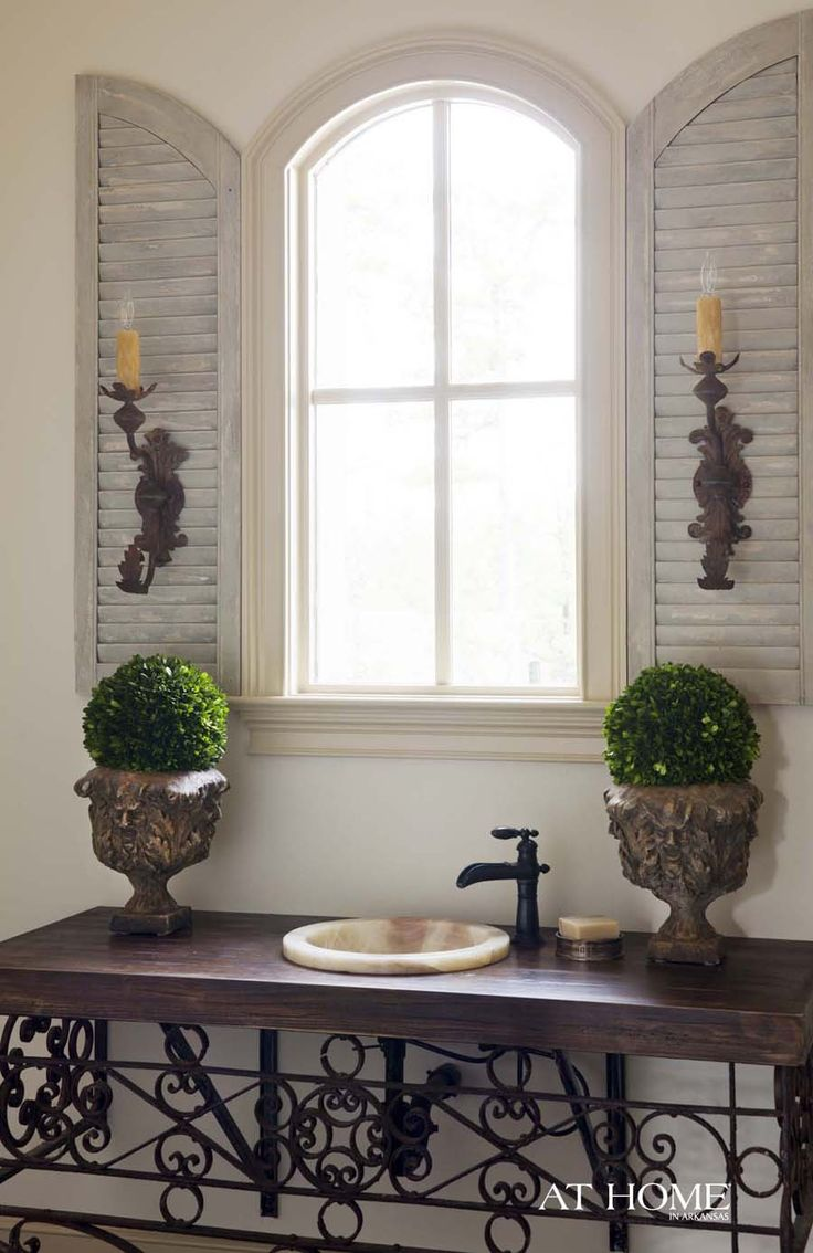 Love the use of shutters inside the home to flank the window--can adapt this to any style.