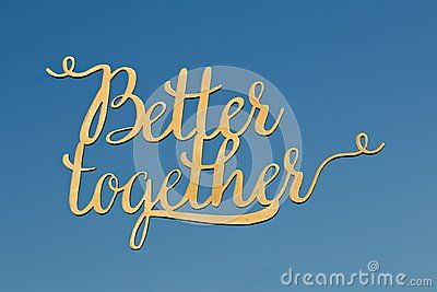 Gold hand writing text isolated on blue sky background. Text `better` and `together` in gold uppercase and lowercase letters.