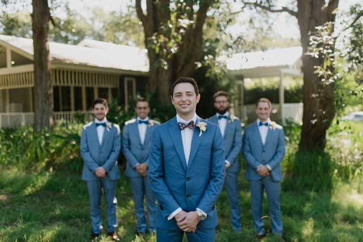 Blue grey suits and bow ties
