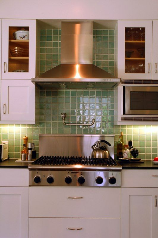 Heath in the kitchen: back splash by Koffka Phakos in Pisces Green using 4x4 tiles