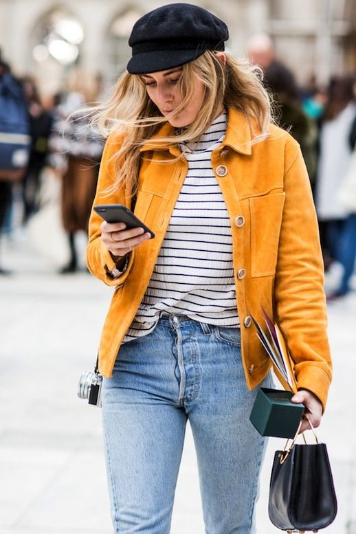 Suede jackets are absolutely everywhere this season, but Lucy Williams manages to stand out from the crowd in her bright hued Topshop jacket. Her bold suede coat looks crazy cool styled with her black cap, striped top and vintage denim.