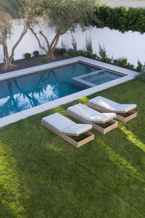 rectangular pool with grass surround