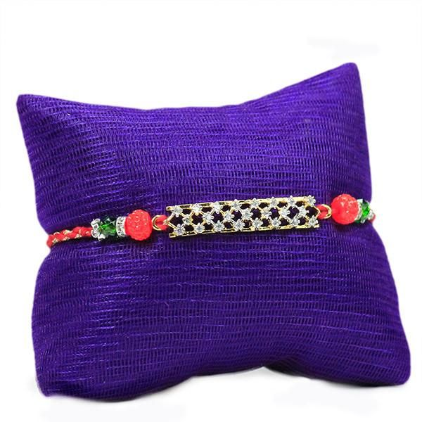 Stone Studded Rakhi The rakhi comes with Roli chawal to make the festival of love even more special. Please note that the cushion shown in the image is for display purpose only.   Rs. 474   Shop Now   https://hallmarkcards.co.in/collections/rakhi/products/gifts-online-for-raksha-bandhan